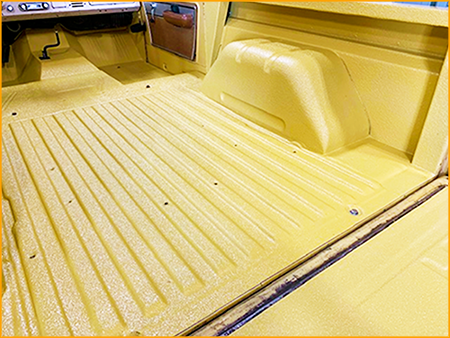 70's Bronco interior floor and bed sprayed with GatorHyde polyurea basecoat and topcoated with Golden Rod automotive urethane paint.